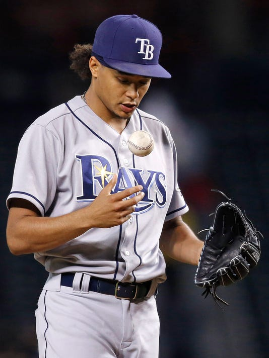 Tampa Bay Rays' Chris Archer tosses the baseball up in the air between pitches against the Arizona Diamondbacks during the first inning of a baseball game Monday, June 6, 2016, in Phoenix. (AP Photo/Ross D. Franklin)