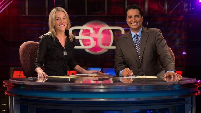 """Lindsay Czarniak, left, and Kevin Negandhi host show on the set of ESPN's SportsCenter. The sports programming giant accuses Verizon of """"breach of contract."""""""