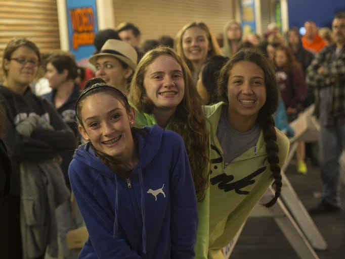 Taylor Bellardino, 13, Colleen Sturges, 14, and Claire Donahue, 14, all of Parsippany, NJ, wait happily in line for the WPLJ's The Todd Show's Summer Kickoff Concert at Jenkinson's Boardwalk. in Point Pleasant NJ on May 23, 2014.