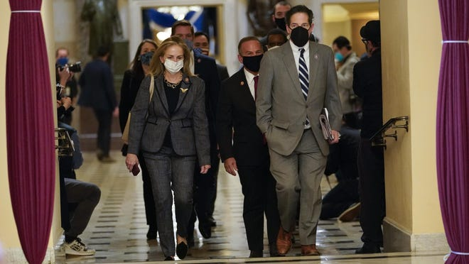 Impeachment managers Rep. Madeleine Dean, D-Pa., and Rep. Jamie Raskin, D-Md., walk to the House chamber on Capitol Hill in Washington, Wednesday, Jan. 13, 2021.