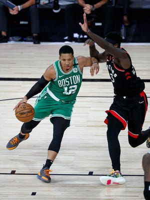 Boston Celtics forward Grant Williams (12) dribbles the ball around Toronto Raptors forward Pascal Siakam (43) during the second half in game three of the second round of the 2020 NBA Playoffs at ESPN Wide World of Sports Complex on Sept. 3, 2020.