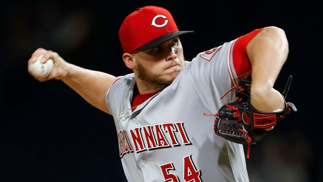 Cincinnati Reds starter Rookie Davis pitches against the Pittsburgh Pirates in the first inning.