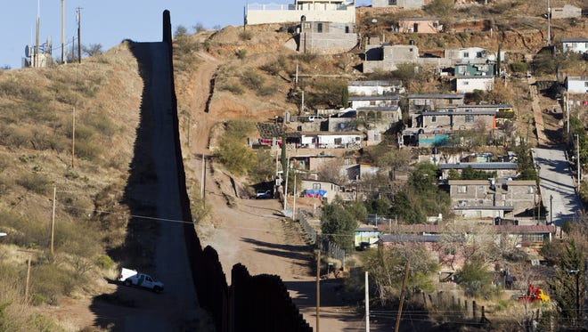 The border fence between the U.S. and Mexico is shown in Nogales.