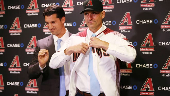 Arizona Diamondbacks Executive Vice President & General Manager Mike Hazen (left) introduces their new manager Torey Lovullo during a press conference at Chase Field on Nov. 7, 2016 in Phoenix, Ariz.