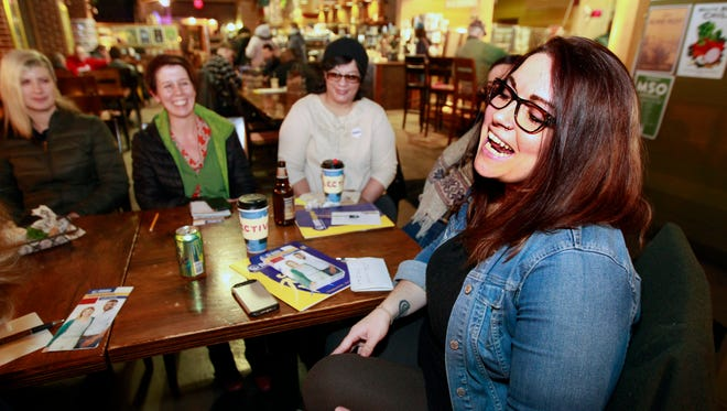 Melanie Heindl, right, leads a discussion at Colectivo Coffee on Jan. 12 for those planning to attend the Women's March on Washington.