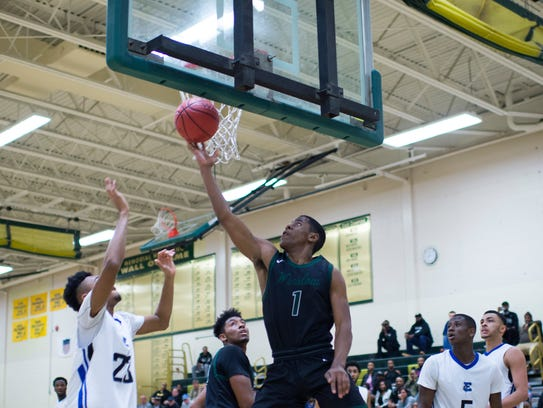 Winslow's Rob Mangum (1) looks for a layup against