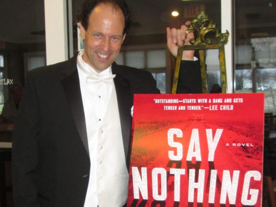 "Brad Parks, a former journalist and award-winning mystery.thriller novelist, has just released his first stand-alone novel, ""Say Nothing."""