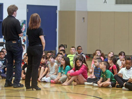Paideia School 15 students listen to instructions before entering a planetarium in the gym.