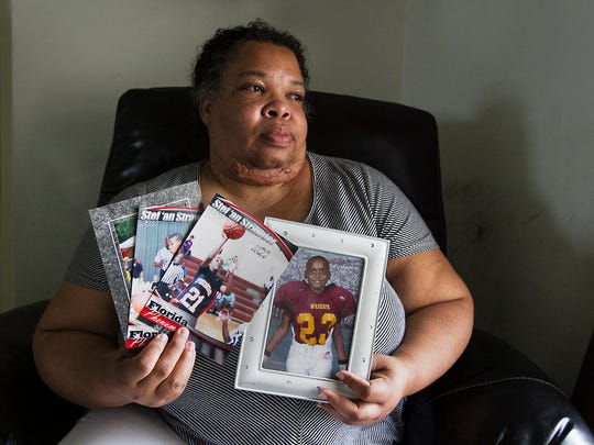 Stephanie White, the mother of Stef'An Strawder and Keith White's sister, was distraught at her home in Lehigh Acres Monday afternoon while displaying a few of her son's photos from younger years.