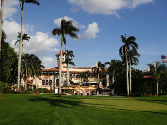 In this Nov. 27, 2016 file photo, Mar-a-Lago is seen from the media van window in Palm Beach, Fla. Trump has described the sprawling Mar-a-Lago property as the Winter White House and has spent two weekends there this month. (AP Photo/Carolyn Kaster)
