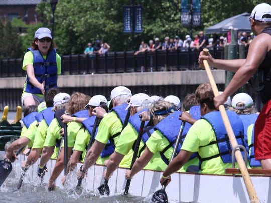 local and regional teams participate in the Inaugural Dragon Boat race Saturday, May 30, 2015, at Tubman-Garrett Riverfront Park in Wilmington, Delaware.