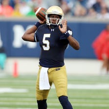 Notre Dame Fighting Irish quarterback Everett Golson (5) throws a pass against the Rice Owls at Notre Dame Stadium.