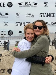Sarah Dean, right, and her mother Barb McKenzie, at the Stance ISA World Adaptive Surfing Championship in La Jolla, California, in 2017.