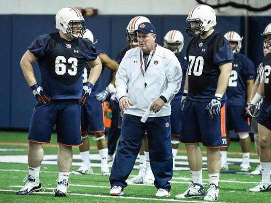 Auburn offensive line coach Herb Hand during spring practice.