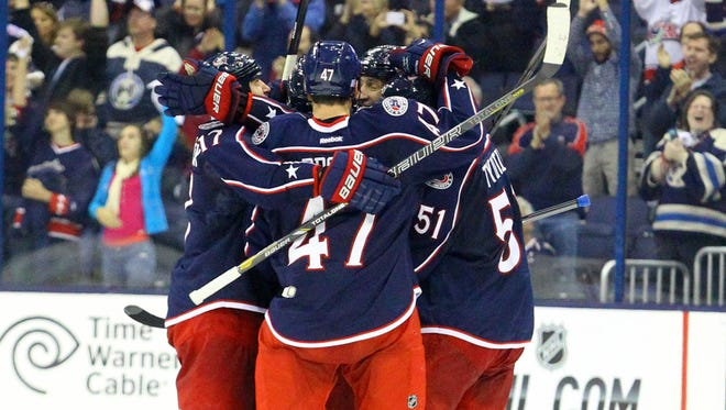 The Columbus Blue Jackets celebrate after sealing a 3-1 win with an empty-net goal.
