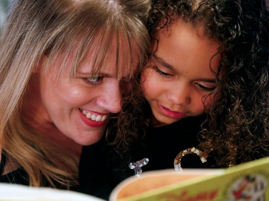 Sydney reads to her mom Amy Bailey on a Saturday evening.   Dec. 12, 2016