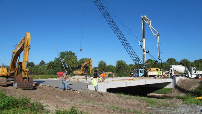 The bridge under construction over the Cocohatchee Canal on the north side of Immokalee Road will be the sole access to a two-story charter school planned on Golden Gate Estates property just east of TwinEagles Golf & Country Club.