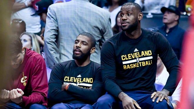 Cleveland Cavaliers guard Kyrie Irving (2) and Cavaliers forward LeBron James (23) on the bench during the first half of a NBA game against the LA Clippers at the Staples Center.