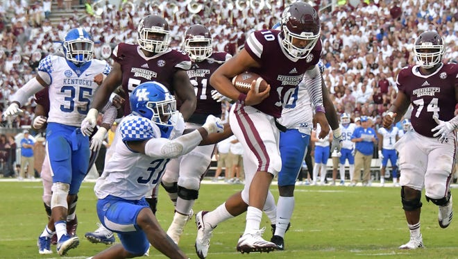 Mississippi State quarterback Keytaon Thompson (10) scores a touchdown against Kentucky linebacker Jamar Watson (31) Saturday during the second half at Davis Wade Stadium.