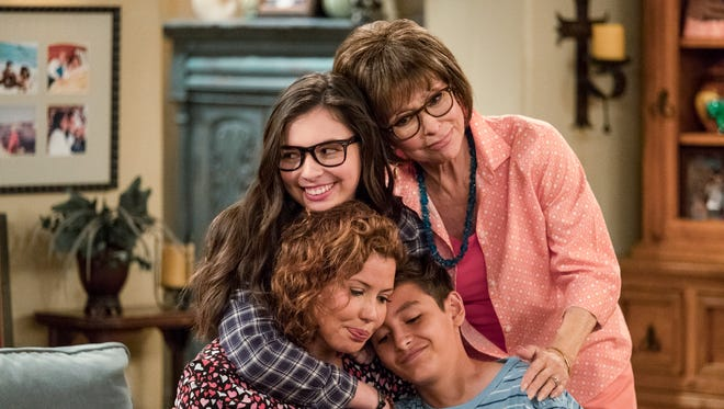 Justina Machado, lower left, stars in Netflix's 'One Day at a Time,' with, clockwise, Isabella Gomez, Rita Moreno and Marcel Ruiz. The 1970s reboot is still breaking new ground,dealing with PTSD, pay inequality and LGBTQ issues.