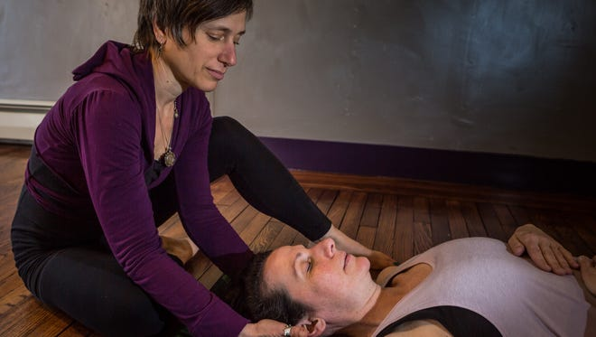 Bonnie Pariser is a trauma release exercise practitioner and owner of Yoga Loka in Frenchtown.