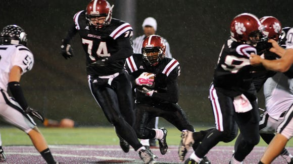 Asheville High's Cameron Ray carries the ball during last Friday's 46-0 home win over North Buncombe.