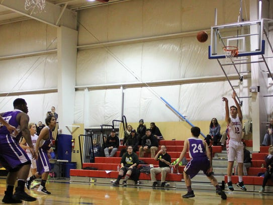 Crosshill Christian's Luke Cotter (12) makes a 3-pointer