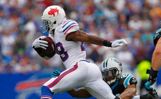 Buffalo's C.J. Spiller, left, gets tripped up by Carolina's Mike Mitchell during football action between the Buffalo Bills and the Carolina Panthers at Ralph Wilson Stadium in Buffalo Sunday afternoon, September 14, 2013.