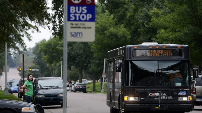 A Sioux Area Metro bus approaches a stop Tuesday along Grange Avenue in front of Augustana College.