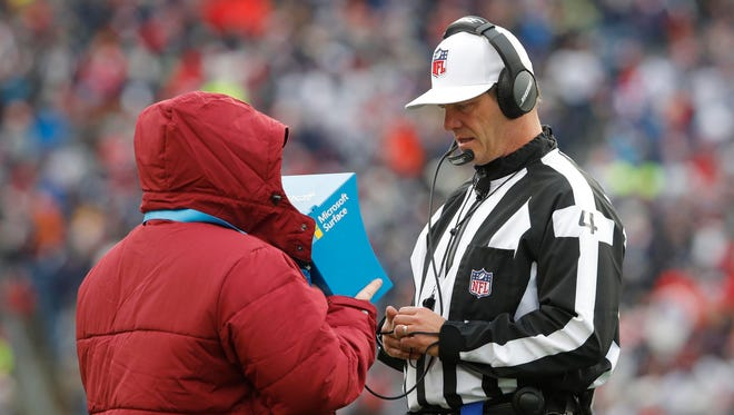 Dec 24, 2017; Foxborough, MA, USA; An official reviews a first down play for the New England Patriots as they take on the Buffalo Bills in the second half at Gillette Stadium. Mandatory Credit: David Butler II-USA TODAY Sports