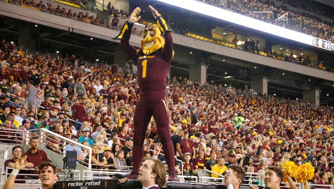 Sparky cheers after the Sun Devils score a touchdown against Oregon at Sun Devil Stadium in Tempe on Sept. 23, 2017.