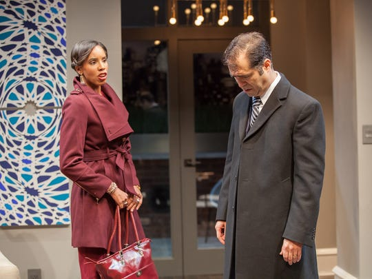 "Jory (Krystel Lucas, left) fires a parting shot at her colleague Amir (Barzin Akhavan, right) in the Playhouse in the Park's production of ""Disgraced."" Ayad Akhtar's Pulitzer Prize-winning play runs through Oct. 23."