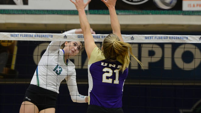 Along with her UWF teammates, Rachel Neblett, shown spiking the ball past North Alabama's Peyton Lang in Sunday's GSC title game, learned Monday night they will get a rematch against UNA in the NCAA Division II Tournament on Dec. 1.