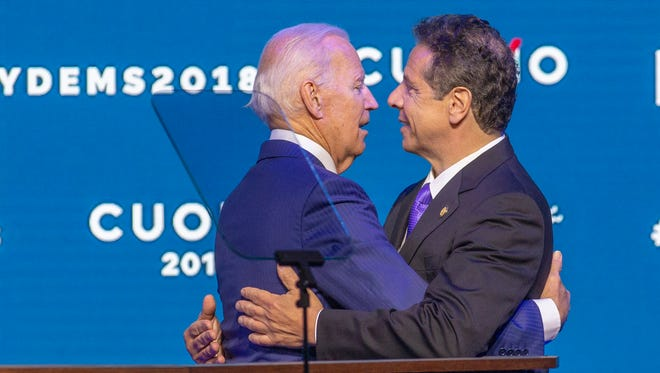 "Former Vice President Joe Biden, left, embraces New York Gov. Andrew Cuomo after endorsing Cuomo for reelection, on the opening day of the New York State Democratic Convention at Hofstra University in Hempstead, N.Y., Thursday May 24, 2018. In a forceful rebuke to President Donald Trump and other Washington Republicans, Biden told fellow Democrats that the GOP has abandoned traditional American values in the name of ""phony populism"" and ""fake nationalism."""