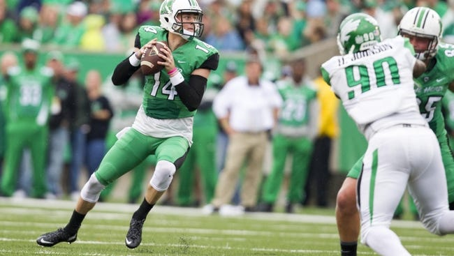 Marshall Thundering Herd quarterback Chase Litton (14) will pose a challenge for the MTSU defense.