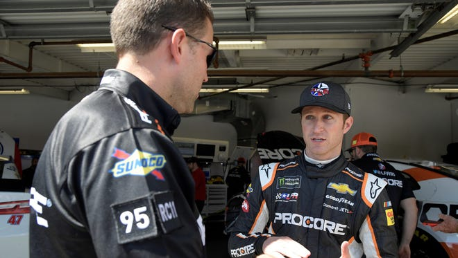 Driver Kasey Kahne, right, talks to a crew member in the garage during practice for the NASCAR Daytona 500 auto race at Daytona International Speedway Saturday, Feb. 17, 2018, in Daytona Beach, Fla. Kahne raced at Williams Grove and Lincoln speedways over the weekend. (AP Photo/Phelan M. Ebenhack)