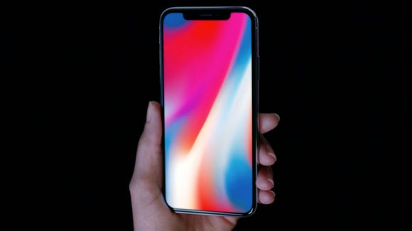 "The new iPhone X—pronounced ""ten""—features an edge-to-edge"