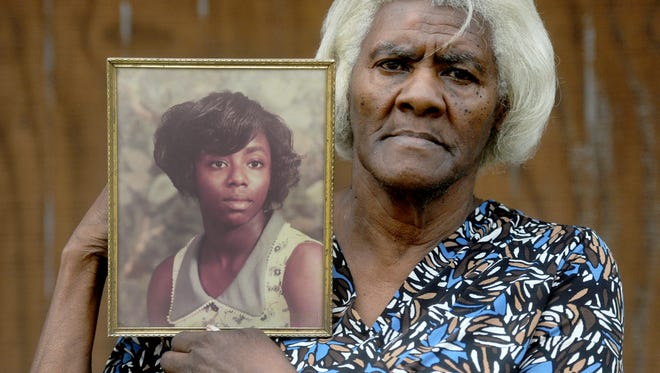 Addie Jones, of Haughton, holds a photo of her daughter, Juanita Jones, who was killed 25 years ago while working at a Circle K convenience store in Haughton. The case has never been solved.