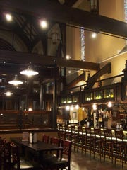 The ceiling of the bar and dining area at Three Guys and a Grill at Trinity is vaulted, and not very different than it appeared before the building was transformed from a church to a restaurant.