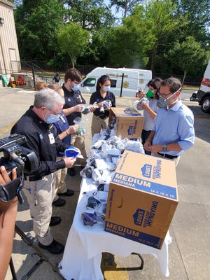 Members of the Clubhou.se donates masks it designed and produced to Gold Cross EMS on May 22. The technology and innovation accelerator group produced 500 masks for first responders to protect them from the COVID-19 virus. The Clubhou.se has produced enough masks to accept orders from the general public at valormask.com.