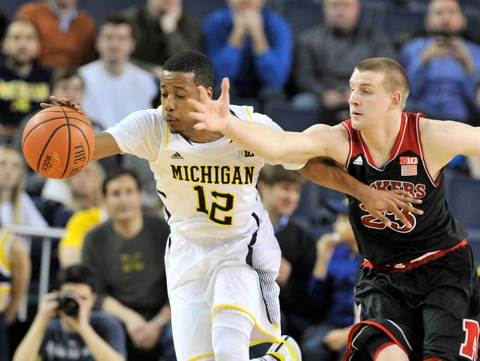 Michigan's Muhammad-Ali Abdur-Rahkman (12) gets to