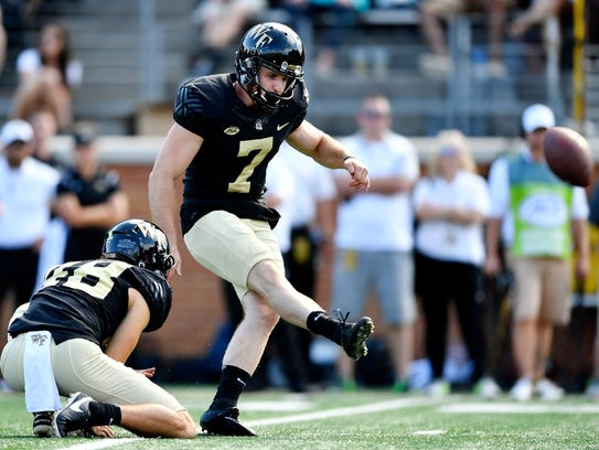 Mike Weaver kicks a field goal  for Wake Forest on