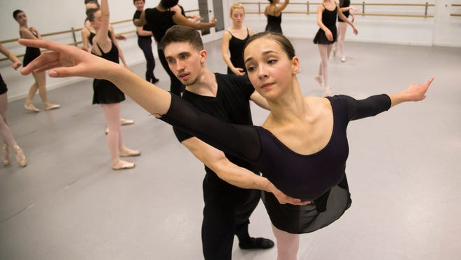Ballerina Gisele Bethea works with Michal Wozniak during a class at the Master Ballet Studio in Scottsdale Jan. 6, 2015. The 15-year-old from Mesa has been called the best dancer of her age in the world  and has gotten a very rare, prestigious contract offer from American Ballet Theatre in New York City.