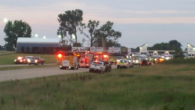 Emergency response vehicles gather at Great Lakes Dragaway on Sunday, Aug. 13, 2017, near Union Grove, Wis. Three men were shot and killed during an auto racing event at the facility, a Wisconsin sheriff said.