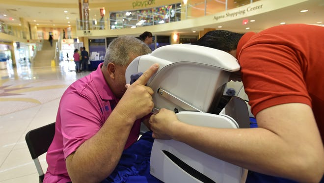 Tom Terlaje, left, participates in the Guam Lion's Club International vision screening at the GFT Health Fair held in Agana Shopping Center on Aug. 15.