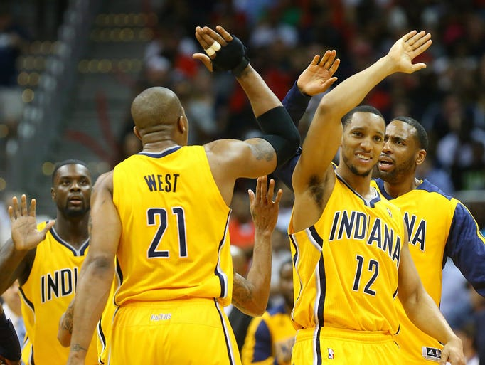 The Indiana Pacers' David West (21) celebrates hitting a 3-pointer with Evan Turner (12) with 1:33 left in the second half against the Atlanta Hawks in Game 4 of an NBA Eastern Conference quarterfinal at Philips Arena in Atlanta, Saturday, April 26, 2014. Indiana won, 91-88, to tie the series. (Curtis Compton/Atlanta Journal-Constitution/MCT)