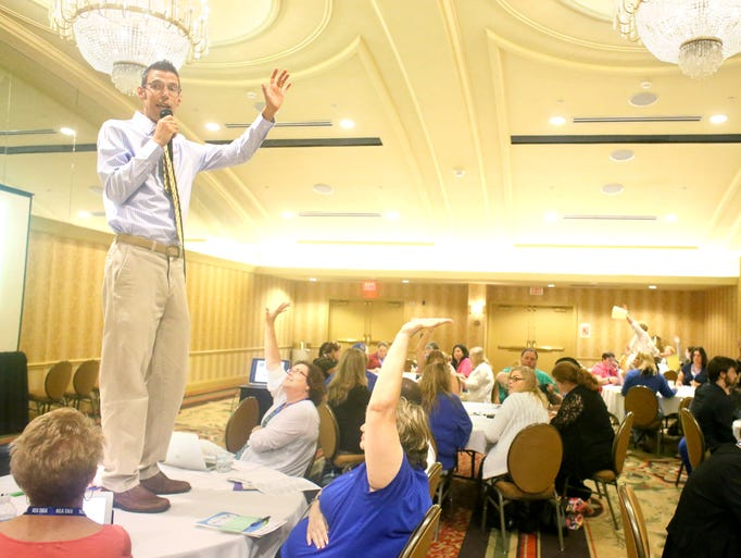 Laurel County 5th grade teacher Jon Eppley speaks during a teachers conference called Let's Talk at the Crowne Plaza Hotel. June 17, 2014