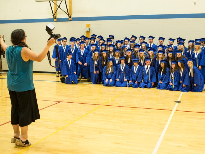 Art-Photography teacher Angie Heckman assembles The Scholars of Distinction for a group photo