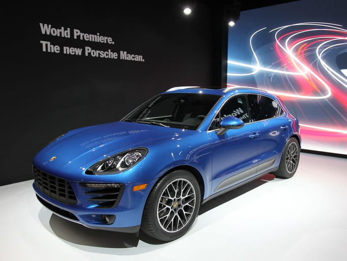 Small urban SUVs are hot and Porsche, with its new Macan (shown here on display at the Los Angeles Auto Show) will test demand for one that is sportier, smaller and pricier than most in the segment.