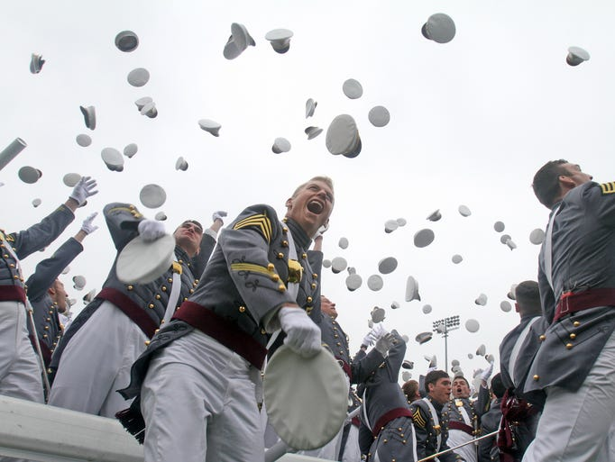 Members of the United States Military Academy graduating class of 2014 toss their caps in the air at the end of commencement exercises at West Point May 28, 2014. President Barack Obama spoke at the graduation, laying out his vision for American foreign policy after the nation fought two wars since the attacks of Sept. 11, 2001.